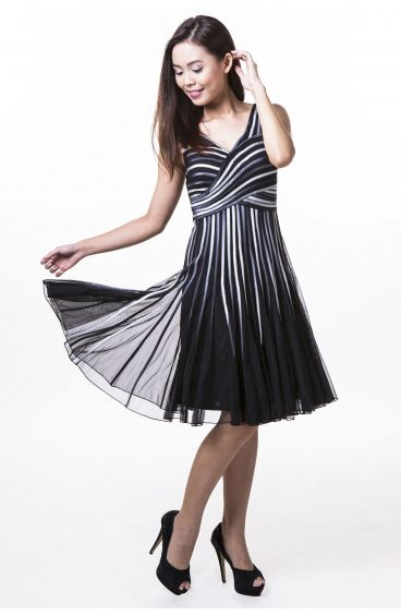 Black dress with blue and silver strips sewn on tulle netting