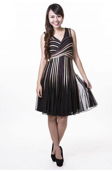 Black dress with brown and gold strips sewn on tulle netting